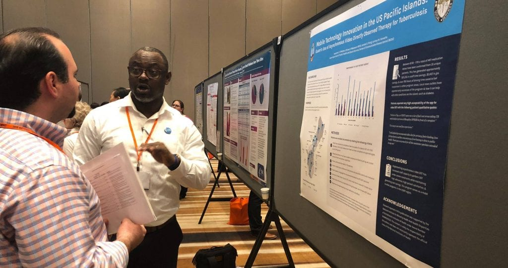 Chima Mbakwem discusses the information and data included in his poster presentation,